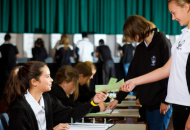 Students take on the role of polling officials in their school's SRC election. Photo: Australian Electoral Commission