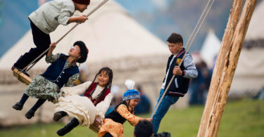 Children on a swing set up for the second World Nomad Games in in September. People from over 40 countries took part in the Games in Kyrgyzstan. Photo: Tabyldy Kadyrbekov, Sputnik, AFP
