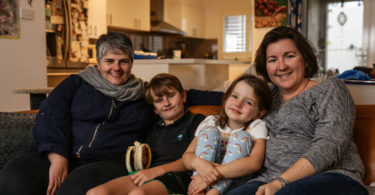 James, nine, and Electra, five, at home in Sydney with their parents, Jodie, left, and Carolyn Nas Jones. Photo: Dallas Kilponen