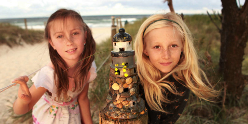 Scout Jones, left, and Aoife Gordos, both eight, admiring the fairy lighthouse on the Brunswick fairy trail created by Ollie Heathwood. Photo: Jacky Ghossein
