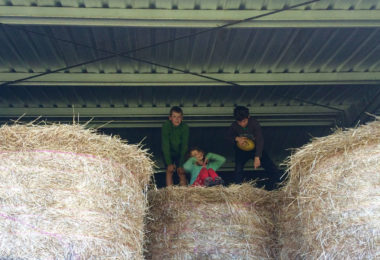 Darcy had a lot of fun playing in these bales of hay with her brother and his friend on her screen-free holiday. Photo: supplied