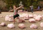 Freya Hannon, aged 5, plays in the gardens of the Crystal Castle in northern NSW. Photo: Jacky Ghossein