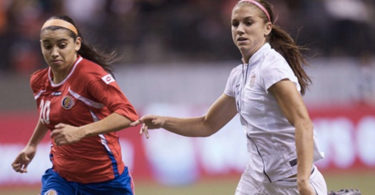 The US soccer player Alex Morgan in an Olympic qualifying game. Photo: ISI Photos, US Soccer