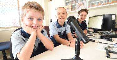 From left, Isaac Spash, six, Amelia Paulsen, nine, and Dan Pereira, 12, at BaptistCare Maranoa Village in Alstonville in northern NSW where they host a radio show. Photo: Marc Stapelberg