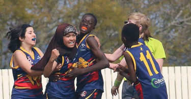 Zimra Hussain, 10, played her first game of AFL in 2015. Now she is known as the 'Afghani Axe' because she tackles so well. Photo: supplied