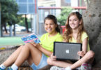 Aria, 12, left, and Nicole, 11 want to get their letters to asylum seeker kids in immigration detention. Photo: Carly Earl