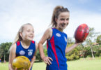 There has been a massive rise in the number of girls playing footy. Zoe Littler, left and Zoe Kertesz, love playing for the East Sydney Bulldogs under 12s AFL side. Photo: Carly Earl
