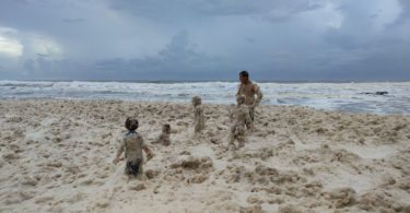 Children playing in sea foam at Valla Beach whipped up by the storms on the NSW coast in mid March. Photo: Kristen Hedgecoe