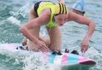 Lani Pallister turned disappointment into success to win the ironwoman title at the Australian Youth Surf Life Saving Championships at North Kirra. Photo: Harvpix