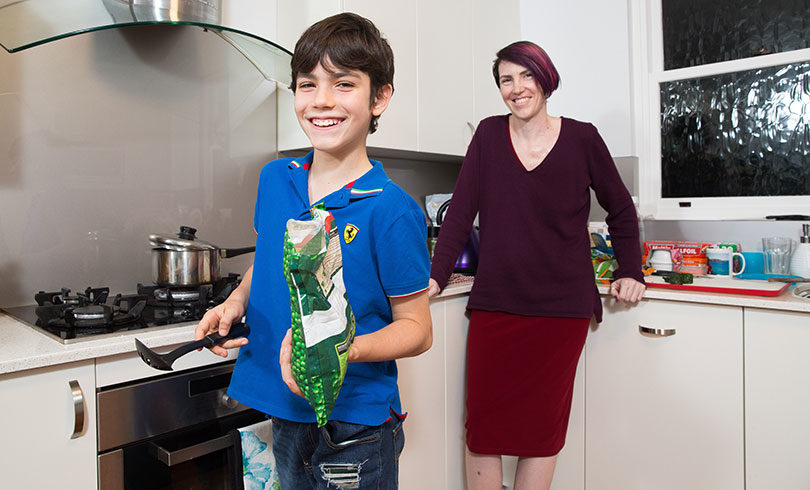 10-year-old Sebastian Belmonte with his mum, who he helps look after. Photo: Carly Earl