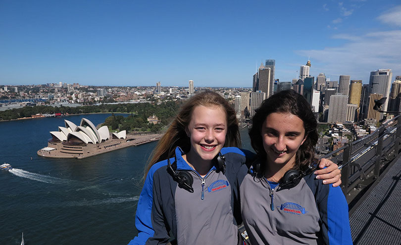 Anouck Heyse, left, and Leilani Mauricio climbed the Sydney Harbour Bridge for Crinkling News. Photo: Bridge Climb