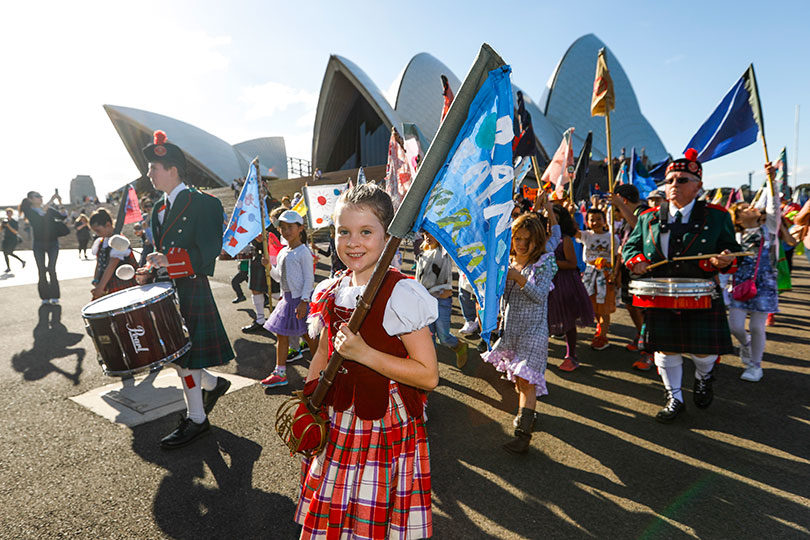 Bronwyn Zapirain, 10, with her flag at the parade for the Children's Republic of Sydney school holiday event at the Sydney Opera House. Photo: Dallas Kilponen
