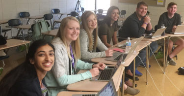 Journalists from The Booster Redux student newspaper at Pittsburg High School in Kansas in the USA. Gina Mathew, 17, is at the front and Maddie Baden, also 17, is third from front. Photo: supplied