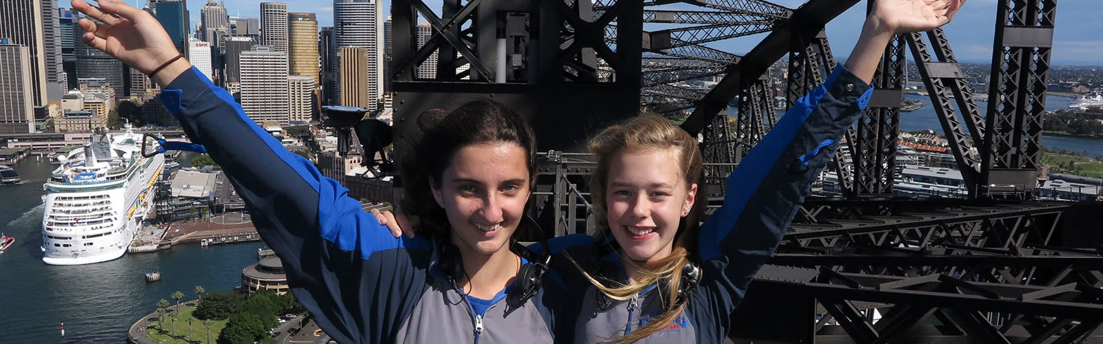 Leilani Mauricio, left, and Anouck Heyse climbed the Sydney Harbour Bridge for Crinkling News. Photo: Bridge Climb