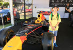 Luke Eaton, 9, wore ear muffs and his Crinkling News reporter T-shit to the Melbourne Grand Prix. Photo: supplied