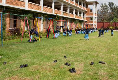 On the swings at the School of St Jude in Tanzania, Africa. Photo: Simon Scott