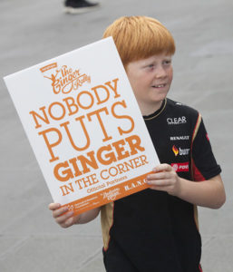 A red-haired boy carries a proud red head sign at the Ginger Pride rally in Melbourne on April 29, 2017. Photo: Elizabeth Clancy