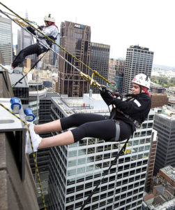 Hannah Yoon, left and Lucinda Phillipson on their way down a Melbourne skyscraper on April 29, 2017. Photo: Elizabeth Clancy