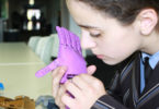 Mia Giannopoulos with a prosthetic hand developed at Ivanhoe Grammar School in Melbourne. Photo: Heather Zubek