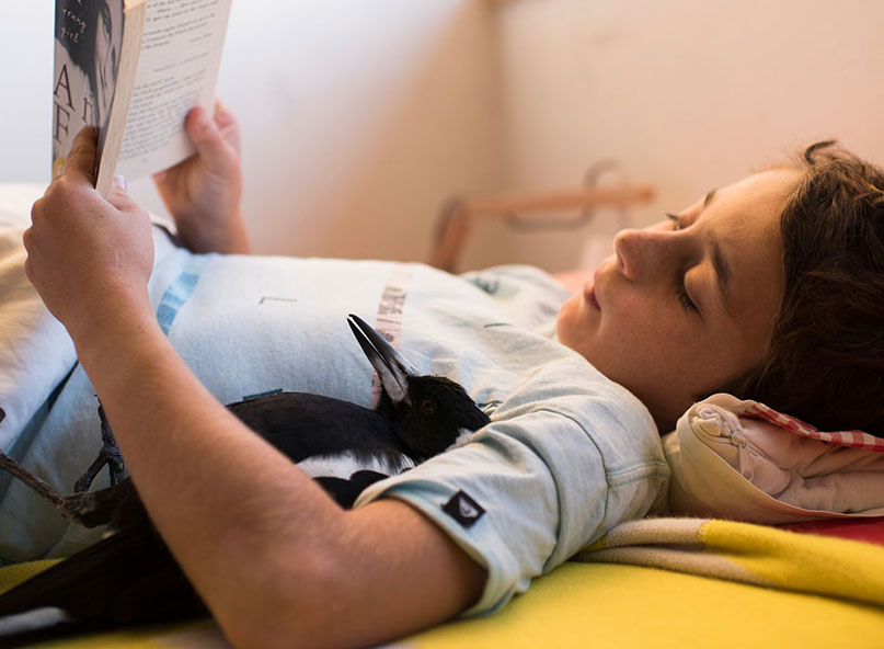 Noah and Penguin reading Anne Frank. Photo: Cameron Bloom