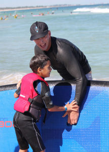 Zak Efferille, aged eight, surfing with the Ocean Heroes at Perth's Trigg beach. Photo: supplied