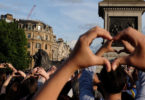 London. At a vigil for the people who died and were hurt in an explosion in Manchester city in England, people made heart shapes with their hands. Photo: Jay Shaw Baker, NurPhoto, AFP