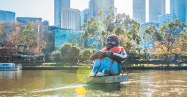 The Inflatable Refugee floats down the Yarra River for Refugee Week. Photo: Stewie Donn
