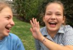 12-year-old twins Jasmine, left, and Ella play in the backyard of their home in Melbourne. Both have cerebral palsy, which can affect movement and speech. Photo: supplied