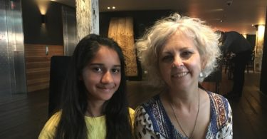 Author Kate DiCamillo with Crinkling News junior reporter, Sanya, at the Sydney Writers' Festival in May 2017. Photo: Crinkling News