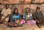 Discoveries at this rock shelter in Kakadu National Park have pushed human habitation in the area back to at least 65,000 years. Traditional owners, from left, Simon Mudjandi, Rosie Mudjandi, May Nango and Mark Djanjomerr. Photo: Glenn Campbell