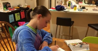 Lucy Straford, 12, writing at home. Photo: Anna Straford