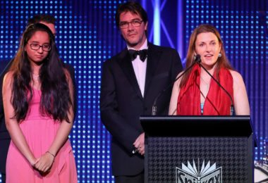 Editor Saffron Howden accepted the trophy along with one of Crinkling News's first junior reporters, Diya Mehta, and its designer, Remi Bianchi. Photo: Salty Dingo