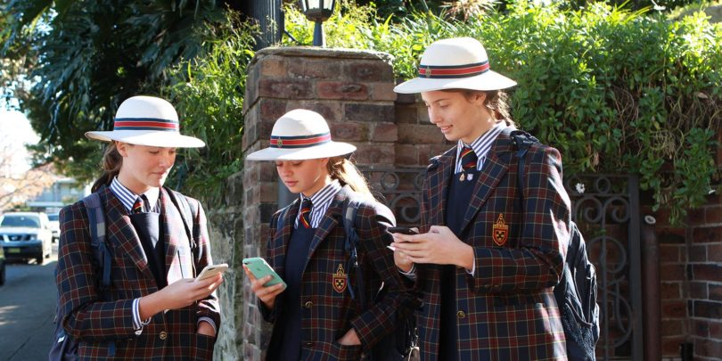 St Catherine's School in Sydney has a ban on mobile phone use during school hours. From left, students Grace Howarth, Sophie Parry-Okeden, and Lauren Nikas, are allowed to look at their phones when school has finished. Photo: Jacky Ghossein