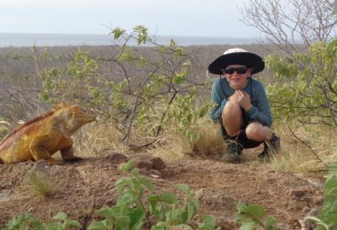 Atticus with a land iguana on the Galapagos Island.