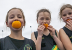Claudia, 8, Keeley, 9, and Gemma, 8, from the Dromana Tigers netball under-9s team, eating fruit at half time. Photo Elizabeth Clancy.jpg
