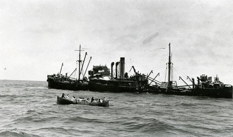 Macumba sinking with one of the lifeboats in the foreground. Photo: Northern Territory Archives Service