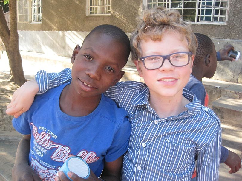 Sam Grindley, right, and Amancio at the orphanage where Sam and Amelia lived for two years.