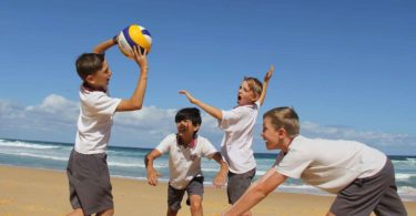 Harbord Public School volleyball players, Curtis Nestlerode, Austin Prosser, Asher Gill and Adam Fejes at Manly Beach last week as they prepare for Volleyfest. Photo: supplied